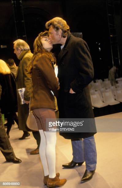 Adeline Blondieau et Johnny Hallyday au defile de mode Christian Dior le 1er fevrier 1991 a Paris France