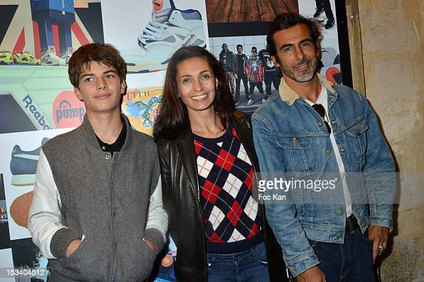 Adeline Blondieau her son Aitor and her partner Laurent Hubert attend the Reebok Ephemeral Beaubourg Flagship Store Opening Party at LÕImprimerie...