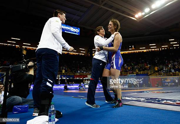 Adeline Gray celebrates with her coaches after defeating Victoria Francis to win their Women's 75kg championship match on day 2 of the 2016 US...
