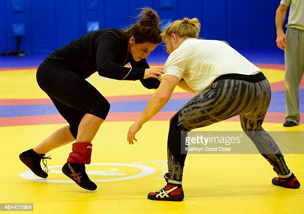 Adeline Gray left a fourtime world championship medalist in wrestling works through her training with fellow teammate Julia Salata at the Olympic...