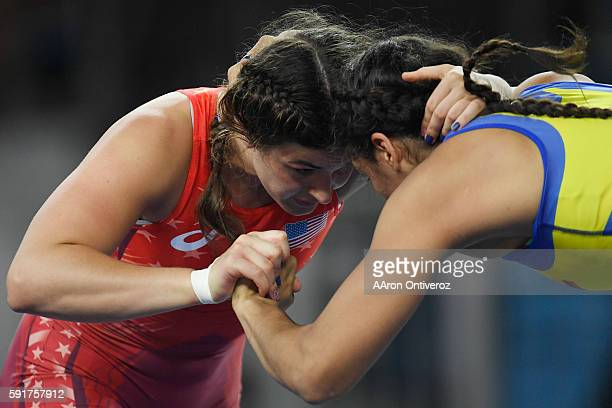 Adeline Gray of the United States grapples with Andrea Olaya of Columbia en route to winning the match by way of a fall during women's freestyle...