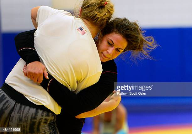 Adeline Gray right a fourtime world championship medalist in wrestling works through her training with fellow teammate Julia Salata at the Olympic...