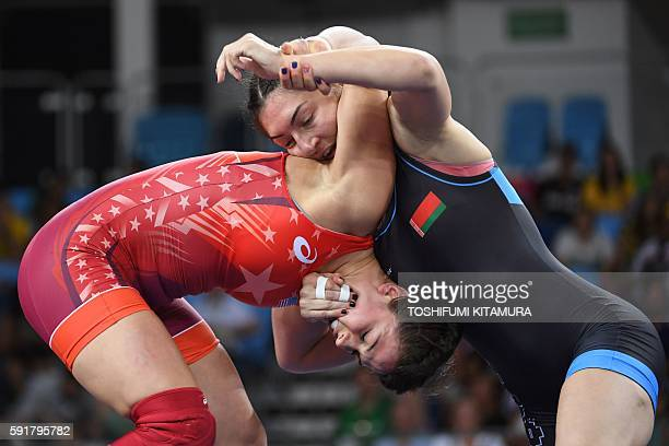 US Adeline Maria Gray wrestles Belarus' Vasilisa Marzaliuk in their women's 75kg freestyle quarterfinal match on August 18 during the wrestling event...
