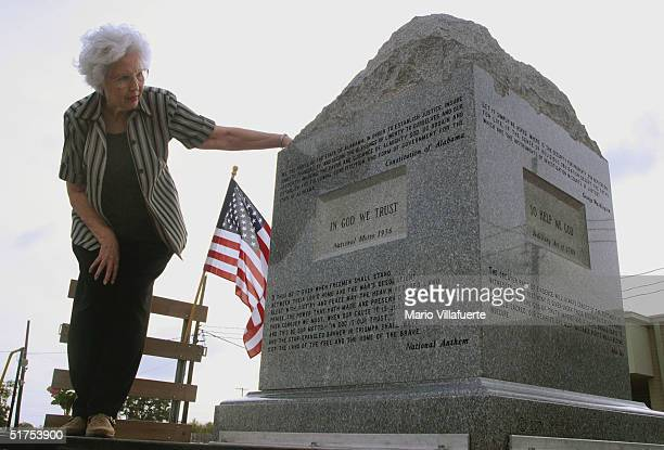 Adelle Grogan of Longview Texas gets a closer look at the granite Ten Commandments monument that was removed in 2003 from the Alabama Judicial...