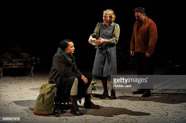 Adelle Leonce as Hoskins Amanda Lawrence as Claxton's wife and Joe Caffrey as Claxton in the National Theatre's production of Caryl Churchill's Light...