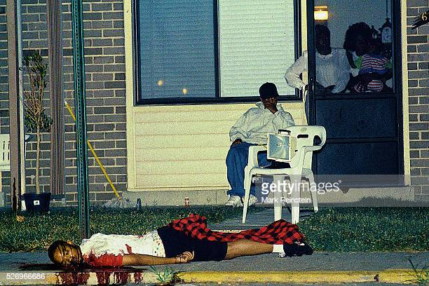 Adelphi Maryland 1993 One of two twin brothers who where shot guned down in a drugrelated murder lays in front of his family's home on Redtop Road in...