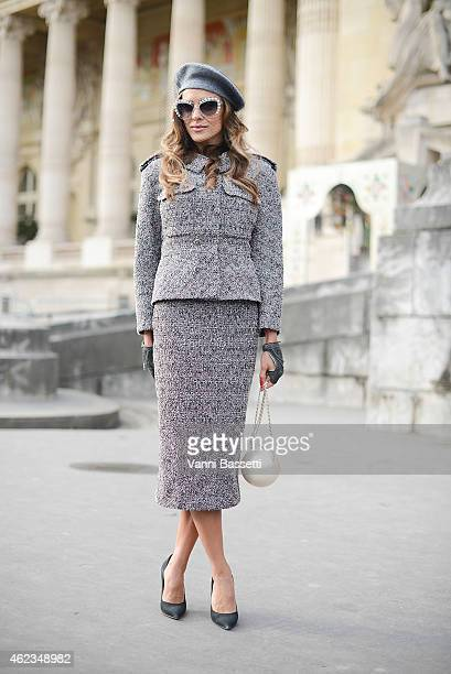 Adelya Bakhtiyarova poses wearing a Chanel total look during day 3 of Paris Haute Couture Spring Summer 2015 on January 27 2015 in Paris France