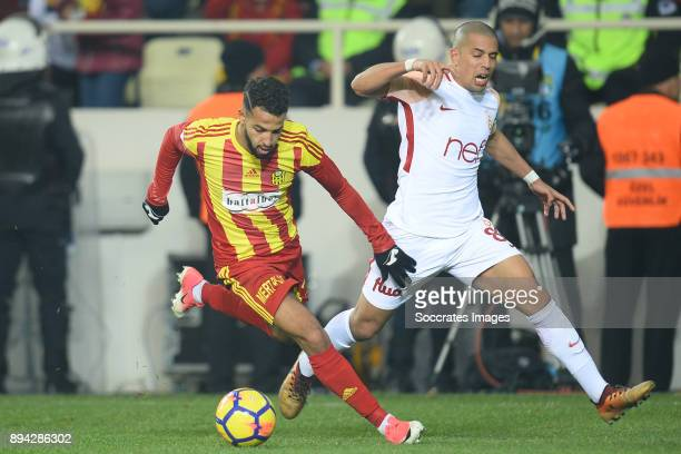 Adem Buyuk of Malatyaspor Sofiane Feghouli of Galatasaray during the Turkish Super lig match between Malatyaspor v Galatasaray at the Malatya Arena...