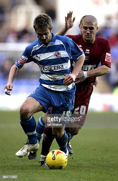 Adem ElAbd of Brighton Hove Albion tries to tackle Kevin Doyle of Reading during the Coca Cola Championship match between Reading and Brighton Hove...