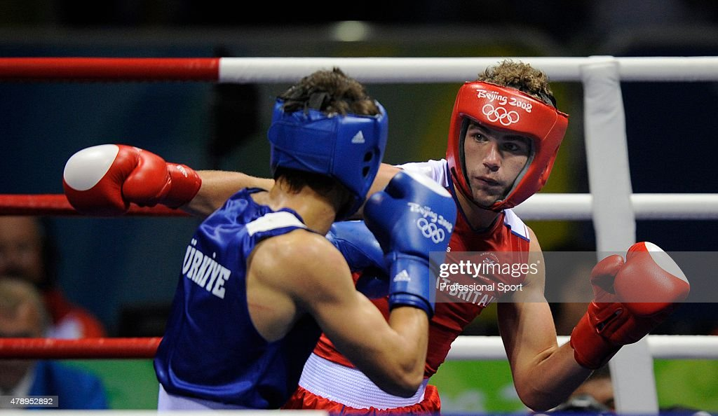 Adem Kilicc (L) of Turkey and Billy Joe Saunders of Great Britain in action during the Men's Welter (69kg) at the Workers' Gymnasium during Day 2 of the Beijing 2008 Olympic Games on August 10, 2008 in Beijing, China.