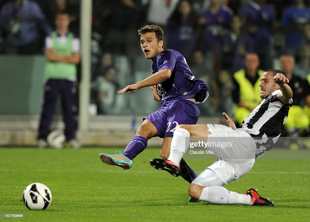 Adem Ljajic of ACF Fiorentina (L) and Leonardo Bonucci of FC Juventus compete for the ball during the Serie A match between ACF Fiorentina and FC Juventus at Stadio Artemio Franchi on September 25, 2012 in Florence, Italy.