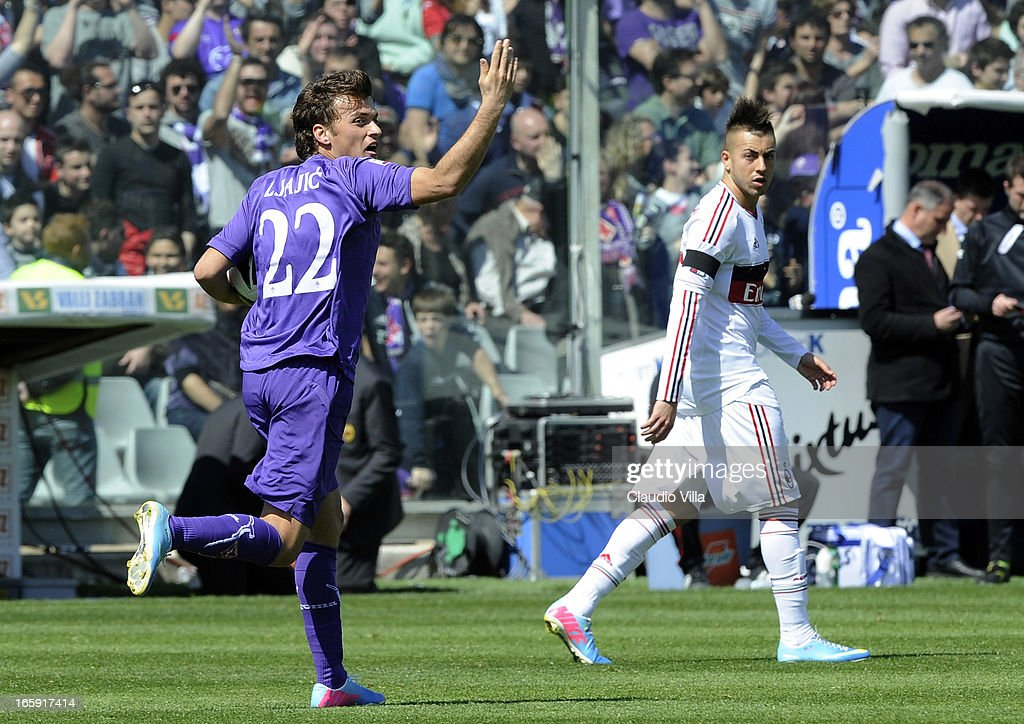 Adem Ljajic of ACF Fiorentina (L) celebrates after scoring his team's first goal from a penalty during the Serie A match between ACF Fiorentina and AC Milan at Stadio Artemio Franchi on April 7, 2013 in Florence, Italy.