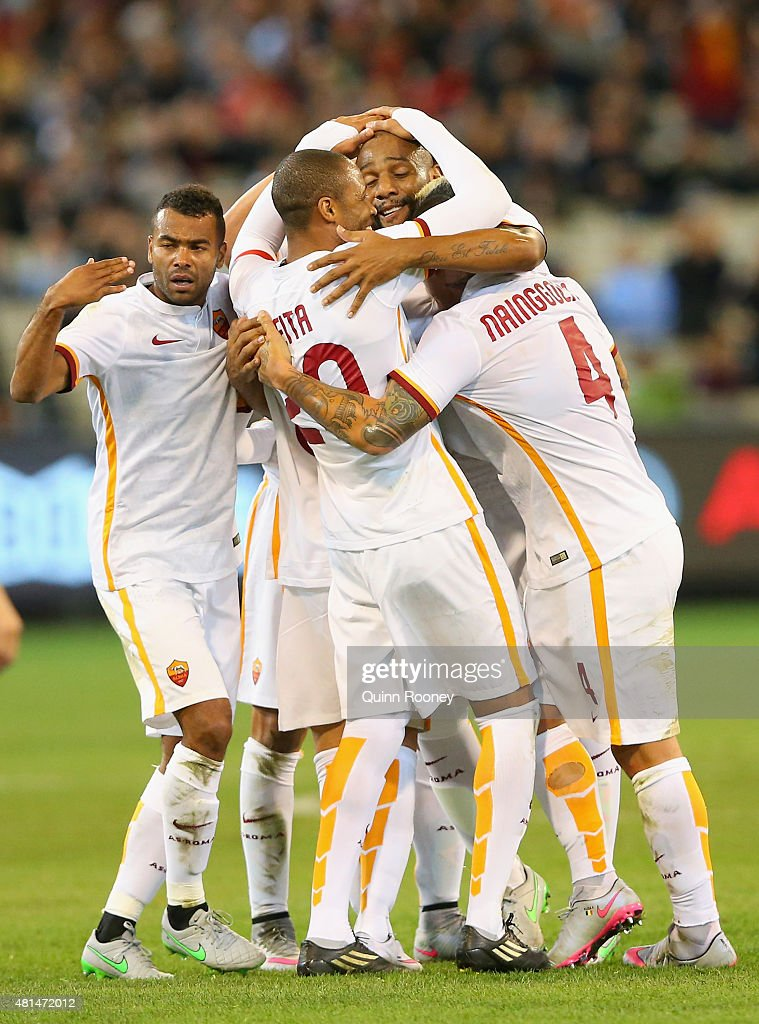 Adem Ljajic of AS Roma is congratulated by team mates after scoring a goal during the International Champions Cup friendly match between Manchester City and AS Roma at the Melbourne Cricket Ground on July 21, 2015 in Melbourne, Australia.