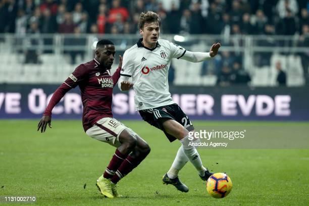 Adem Ljajic of Besiktas in action against Andre Poko of Goztepe during Turkish Super Lig soccer match between Besiktas and Goztepe at Vodafone Park...