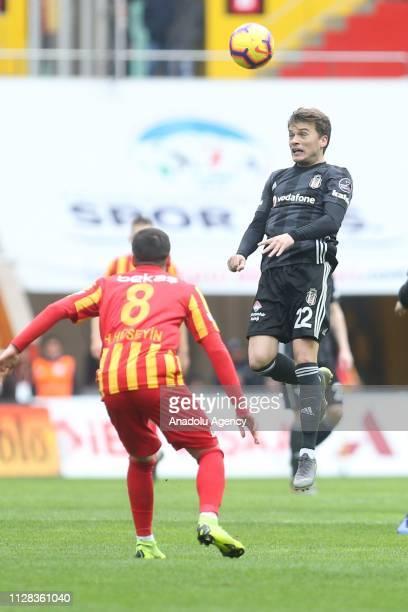 Adem Ljajic of Besiktas in action against Hasan Huseyin Acar of Istikbal Mobilya Kayserispor during the Turkish Super Lig soccer match between...