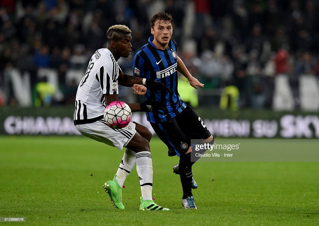 Adem Ljajic of FC Internazionale and Paul Pogba of Juventus (L) compete for the ball during the Serie A match between Juventus FC and FC Internazionale Milano at Juventus Arena on February 28, 2016 in Turin, Italy.