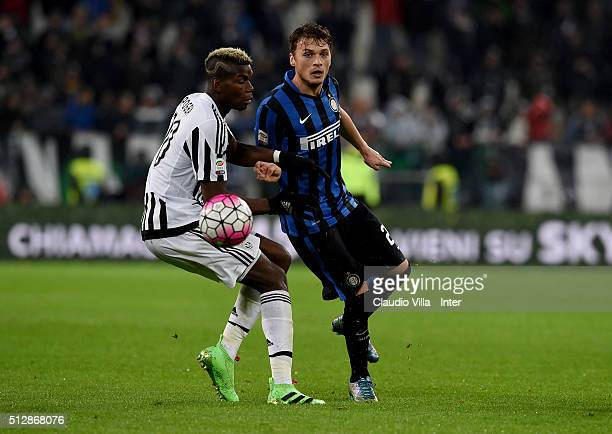 Adem Ljajic of FC Internazionale and Paul Pogba of Juventus compete for the ball during the Serie A match between Juventus FC and FC Internazionale...