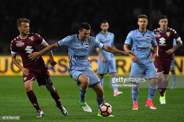 Adem Ljajic of FC Torino competes with Vasco Regini of UC Sampdoria during the Serie A match between FC Torino and UC Sampdoria at Stadio Olimpico di...