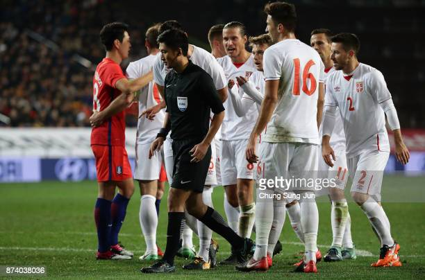 Adem Ljajic of Serbia arfue with referee Ma Ning during the international friendly match between South Korea and Serbia at Ulsan World Cup Stadium on...