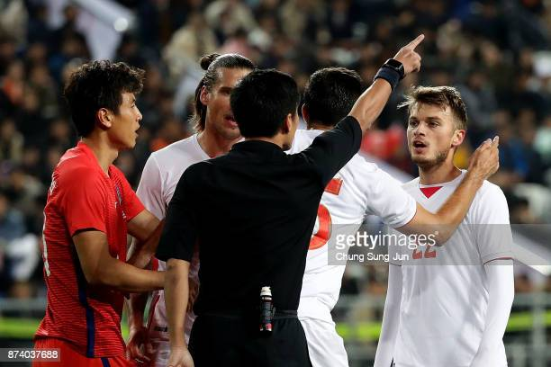 Adem Ljajic of Serbia argue with referee Ma Ning during the international friendly match between South Korea and Serbia at Ulsan World Cup Stadium on...