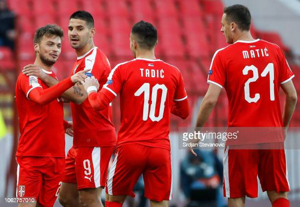Adem Ljajic of Serbia celebrates after scoring a goal with Aleksandar Mitrovic and Dusan Tadic during the UEFA Nations League C group four match...