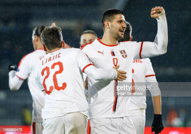 Adem Ljajic of Serbia celebrates after scoring a goal with Aleksandar Mitrovic during the UEFA Nations League C group four match between Serbia and...