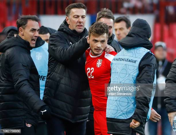 Adem Ljajic of Serbia celebrates after scoring a goal with head coach Mladen Krstajic during the UEFA Nations League C group four match between...