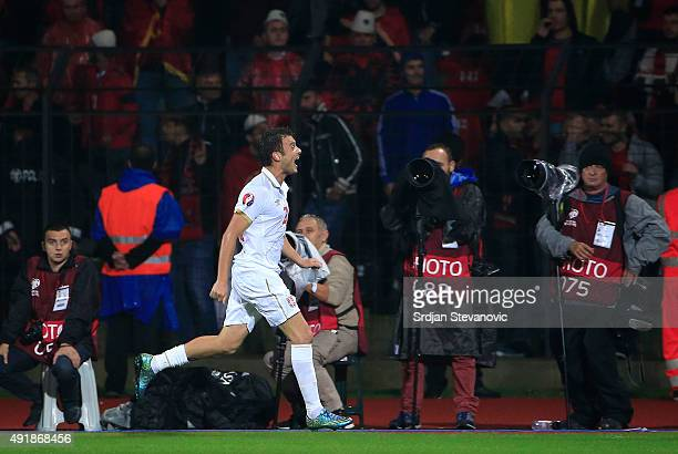 Adem Ljajic of Serbia celebrates the scoring the goal during the UEFA EURO 2016 qualifier between Albania and Serbia at the Elbasan Arena on October...
