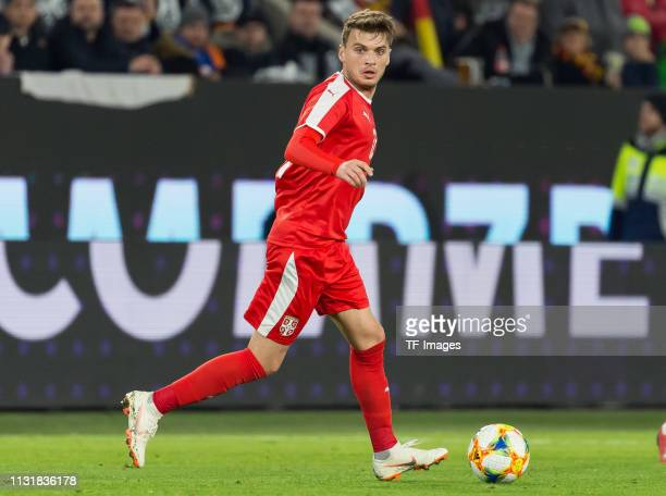 Adem Ljajic of Serbia controls the ball during the International Friendly match between Germany and Serbia at Volkswagen Arena on March 20 2019 in...
