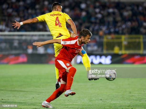 Adem Ljajic of Serbia in action against Cristian Manea of Romania during the UEFA Nations League C group four match between Serbia and Romania at...