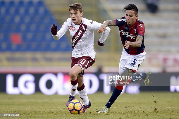 Adem Ljajic of Torino FC and Erick of Bologna FC compete for the ball Pulgar during the Serie A football match between Bologna FC and Torino FC...