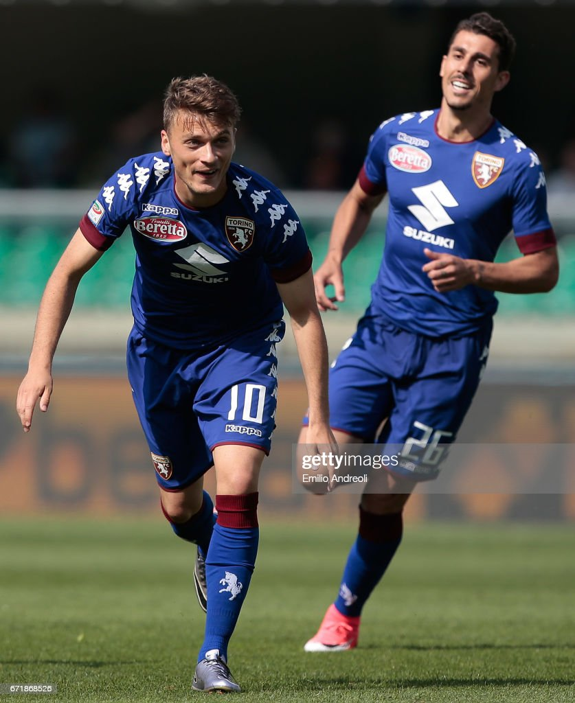 Adem Ljajic of Torino FC (L) celebrates after scoring the opening goal during the Serie A match between AC ChievoVerona and FC Torino at Stadio Marc'Antonio Bentegodi on April 23, 2017 in Verona, Italy.