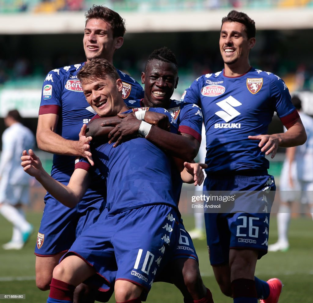 Adem Ljajic of Torino FC (front) celebrates with his team-mates after scoring the opening goal during the Serie A match between AC ChievoVerona and FC Torino at Stadio Marc'Antonio Bentegodi on April 23, 2017 in Verona, Italy.