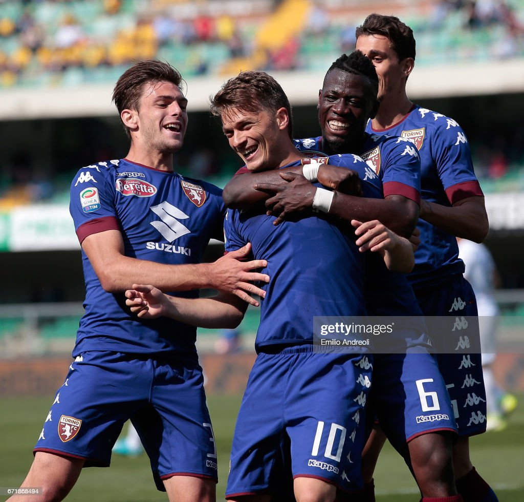 Adem Ljajic of Torino FC (C) celebrates with his team-mates after scoring the opening goal during the Serie A match between AC ChievoVerona and FC Torino at Stadio Marc'Antonio Bentegodi on April 23, 2017 in Verona, Italy.