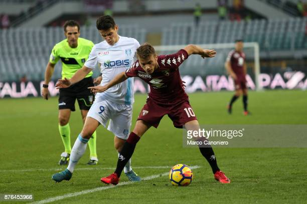 Adem Ljajic of Torino FC in action and Mariusz Stepinski of Chievo Verona during the Serie A football match between Torino Fc and Ac Chievo Verona...