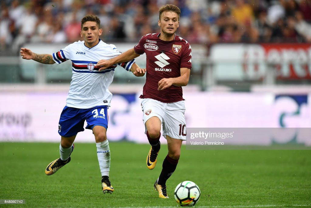 Adem Ljajic (R) of Torino FC is challenged by Lucas Sebastian Torreira of UC Sampdoria during the Serie A match between Torino FC and UC Sampdoria at Stadio Olimpico di Torino on September 17, 2017 in Turin, Italy.