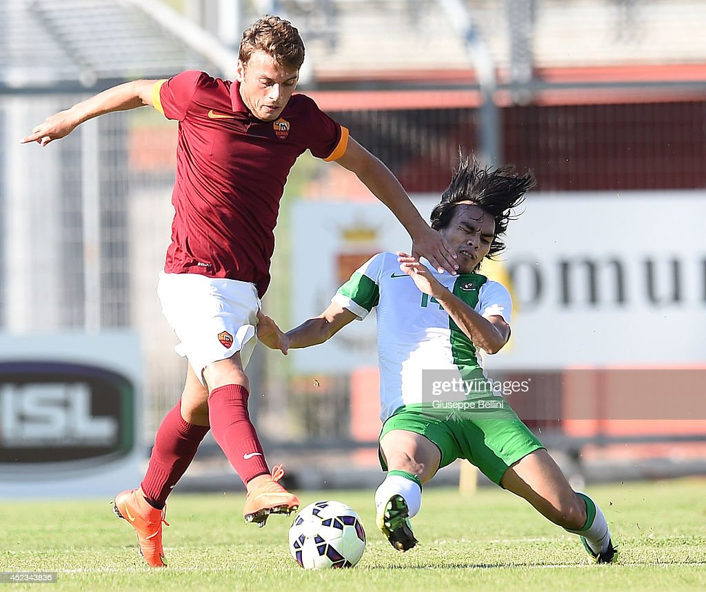 Adem Ljalic of Roma and Rasyid Bakri of Indonesia U21 in action during the friendly match between AS Roma and Indonesia U23 at Stadio Centro d'Italia - Manlio Scopigno on July 18, 2014 in Rieti, Italy.