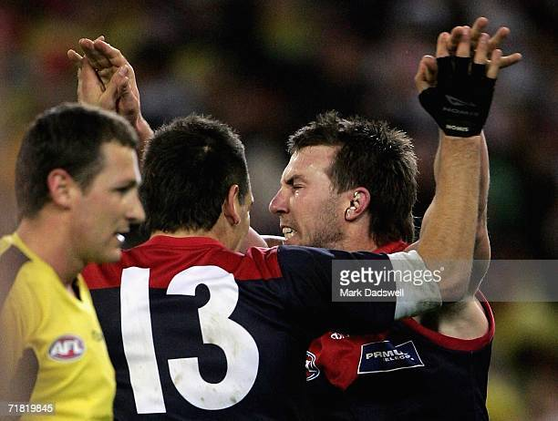 Adem Yze and Brock McLean of the Demons celebratea goal during the AFL Second Elimination Final between the St Kilda Saints and the Melbourne Demons...