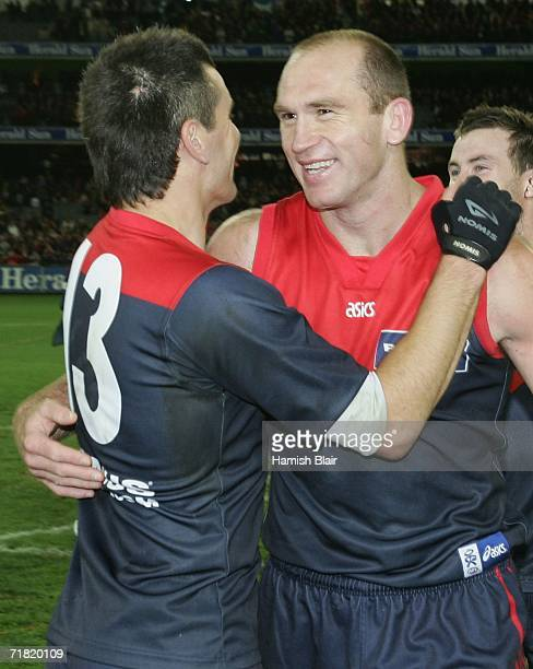 Adem Yze and David Neitz for the Demons celebrate their win after the AFL Second Elimination Final between the St Kilda Saints and the Melbourne...