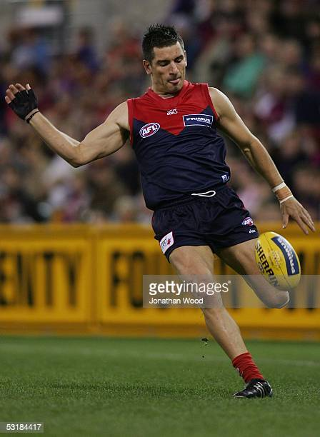 Adem Yze of Melbourne in action during the Round 14 AFL match between the Brisbane Lions and Melbourne Demons at the Gabba on July 2 2005 in Brisbane...