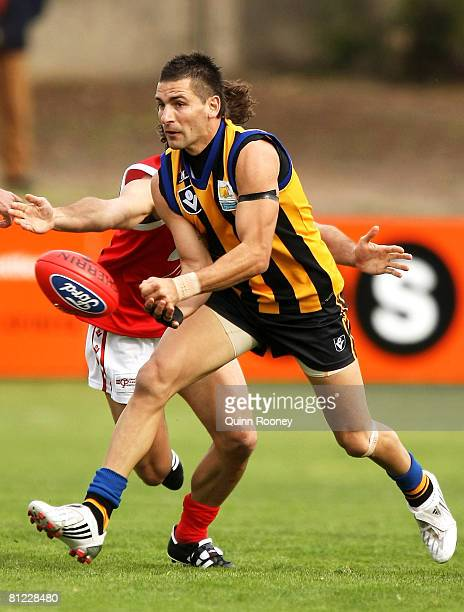 Adem Yze of Sandringham handballs during the round eight VFL match between Sandringham and the Northern Bullants at Trevor Barker Beach Oval on May...