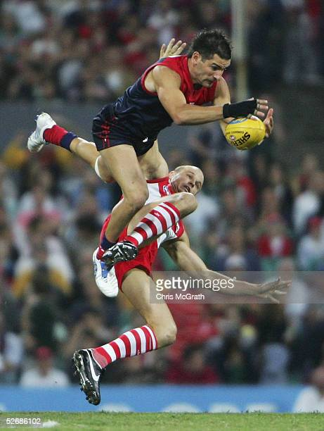 Adem Yze of the Demons flies for a mark during the AFL Round 5 match between the Sydney Swans and the Melbourne Demons at the Sydney Cricket Ground...