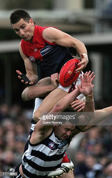 Adem Yze of the Demons flies for a mark on the boundary line during the round 21 AFL match between the Geelong Cats and the Melbourne Demons at...