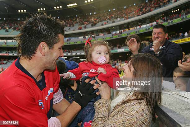 Adem Yze of the Demons is congratulated by his partner Anette and baby daughter Jasmine after playing his 200th AFL match during the round 13 AFL...