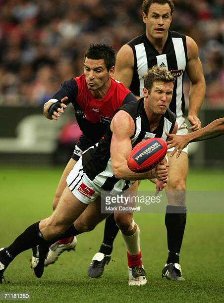 Adem Yze of the Demons tackles Chad Morrison of the Magpies during the round 11 AFL match between the Melbourne Demons and the Collingwood Magpies at...