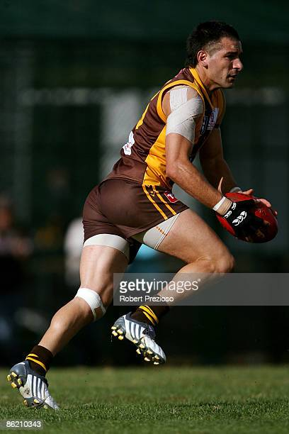 Adem Yze of the Hawks runs with the ball during the round three VFL match between the Box Hill Hawks and the Coburg Tigers at Box Hill City Oval on...