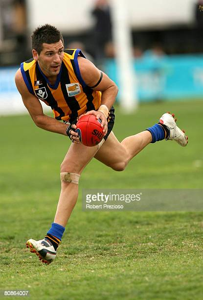 Adem Yze of the Sandringham runs the ball during the round five VFL match between Sandringham and the Bendigo Bombers at Trevor Barker Beach Oval on...