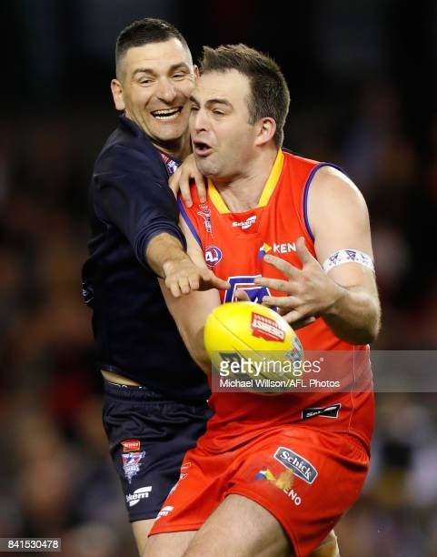 Adem Yze of Victoria and Brian Lake of the All Stars compete for the ball during the 2017 EJ Whitten Legends Game between Victoria and the All Stars...