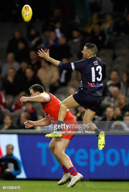 Adem Yze of Victoria marks the ball over Brian Lake of the All Stars during the 2017 EJ Whitten Legends Game between Victoria and the All Stars at...