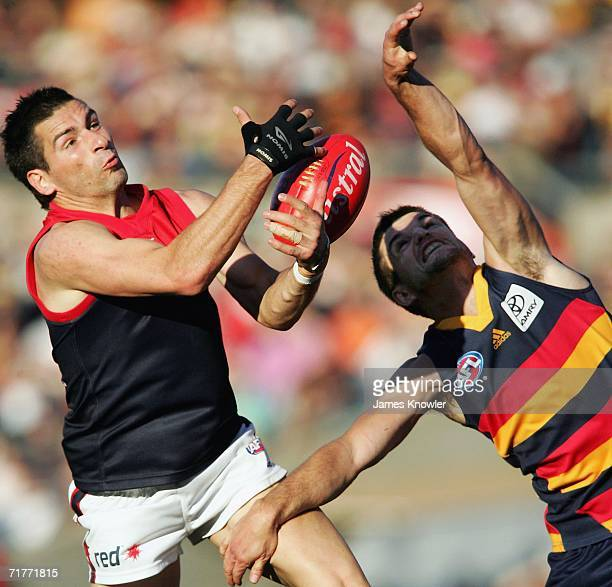 Adem Yze the Demons tries to mark over Nathan Bassett of the Crows during the round 22 AFL match between the Adelaide Crows and the Melbourne Demons...